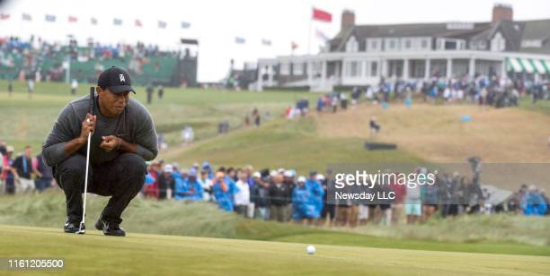 Tiger woods lines up his putt on the first hole during the second Round of the 2018 U.S. Open Championship at the Shinnecock Hills Golf Club in...