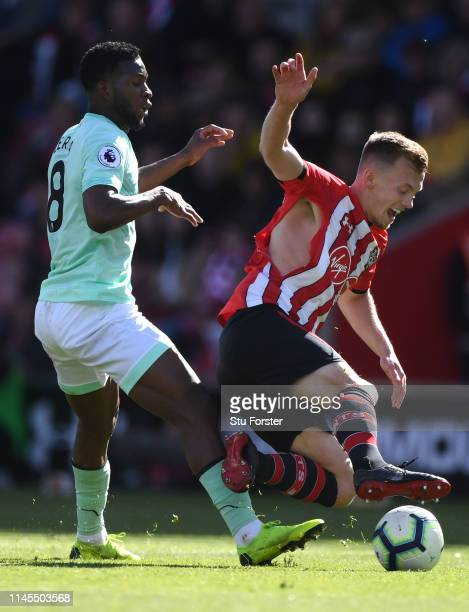 Southampton player James WardProwse is challenged by Jefferson Lerma of Bournemouth during the Premier League match between Southampton FC and AFC...