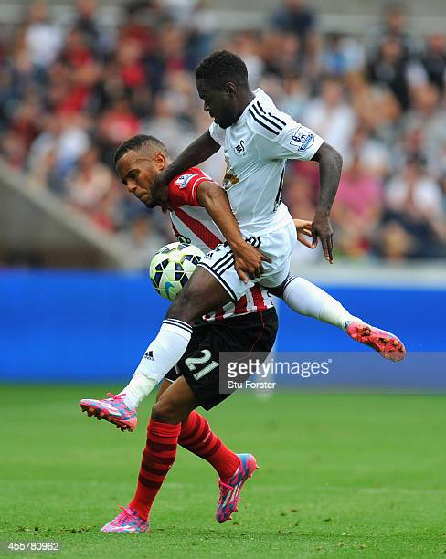 Southampton player Ryan Bertrand is beaten to the ball by Nathan Dyer during the Barclays Premier League match between Swansea City and Southampton...