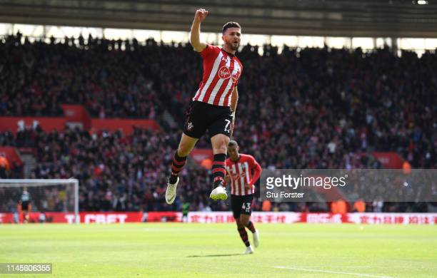 Southampton player Shane Long celebrates after scoring the first goal during the Premier League match between Southampton FC and AFC Bournemouth at...