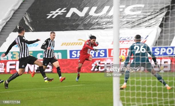 Southampton player Takumi Minamino scores the first Southampton goal past goalkeeper Karl Darlow during the Premier League match between Newcastle...