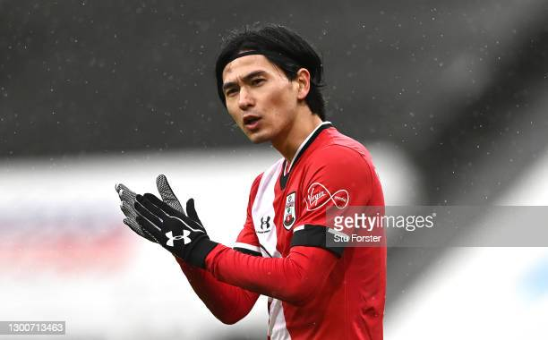 Southampton player Takumi Minamino wearing gloves, gestures during the Premier League match between Newcastle United and Southampton at St. James...