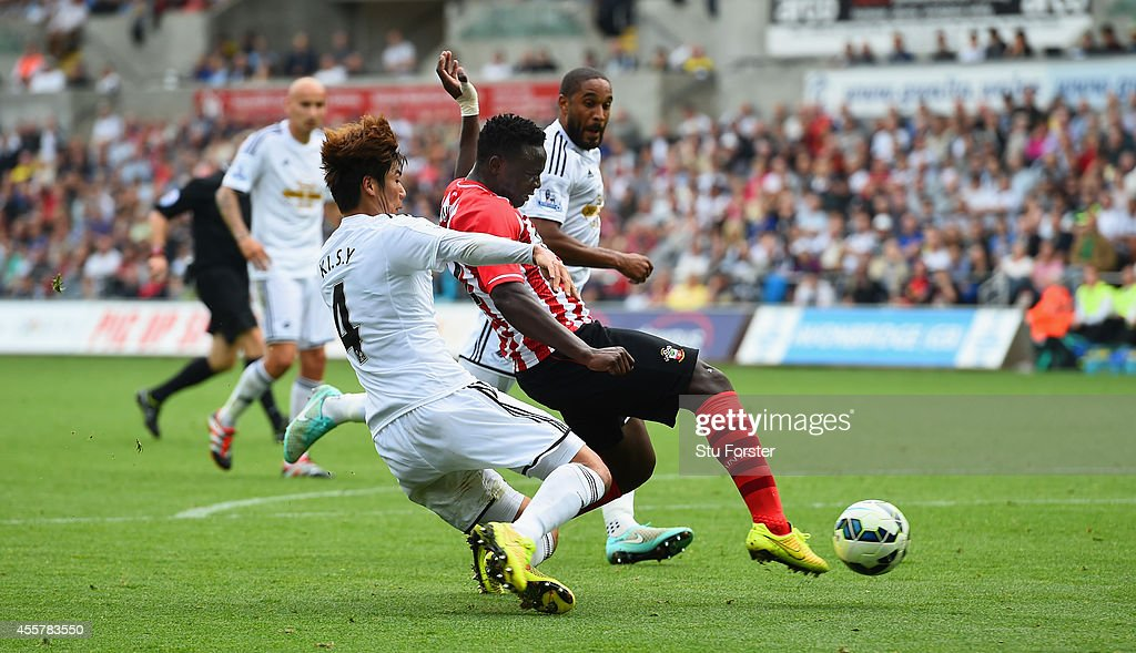 Southampton player Victor Wanyama (r) scores the first goal during the Barclays Premier League match between Swansea City and Southampton at Liberty Stadium on September 20, 2014 in Swansea, Wales.