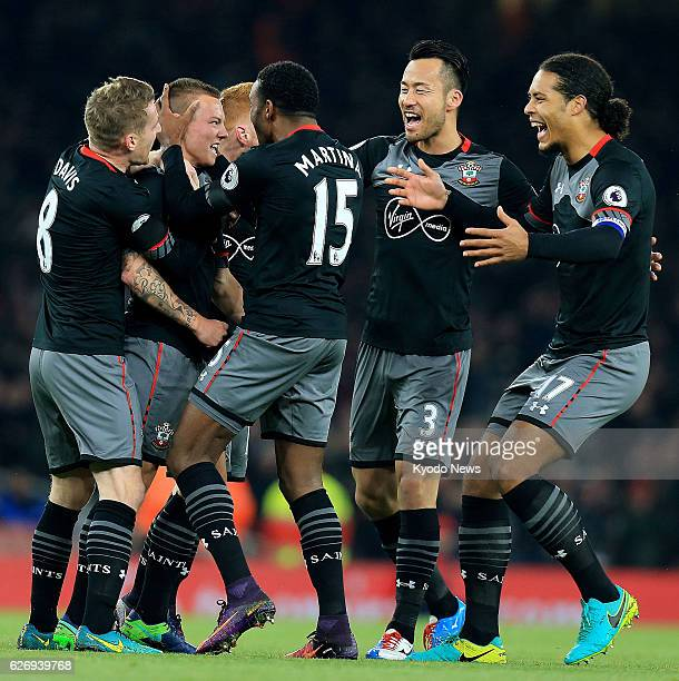 Southampton players celebrate after Jordy Clasie opens the scoring in their 20 away win at Arsenal in the quarterfinals of the League Cup in London...