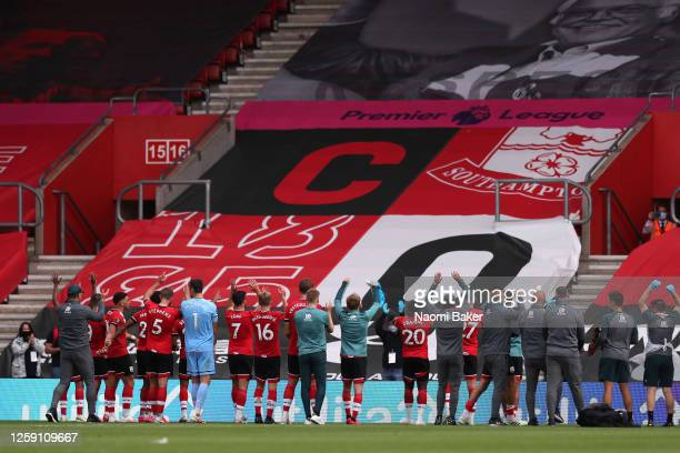 Southampton players celebrate after the Premier League match between Southampton FC and Sheffield United at St Mary's Stadium on July 26 2020 in...