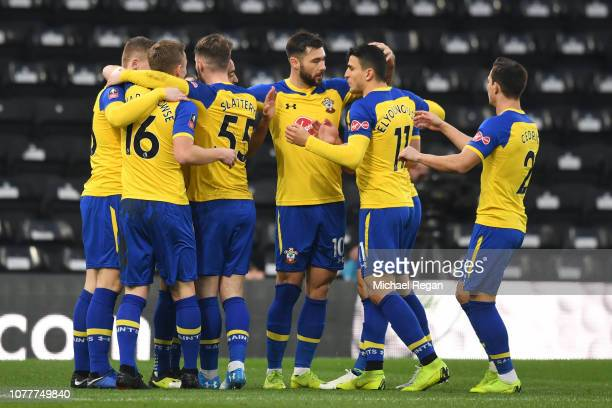 Southampton players celebrate after their team's first goal during the FA Cup Third Round match between Derby County and Southampton at Pride Park on...