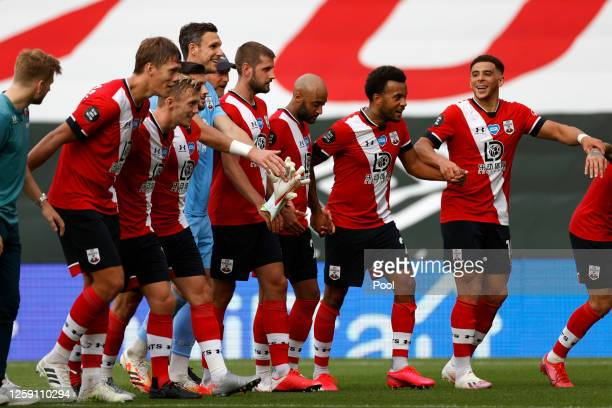 Southampton players celebrate at the end of the Premier League match between Southampton FC and Sheffield United at St Mary's Stadium on July 26 2020...