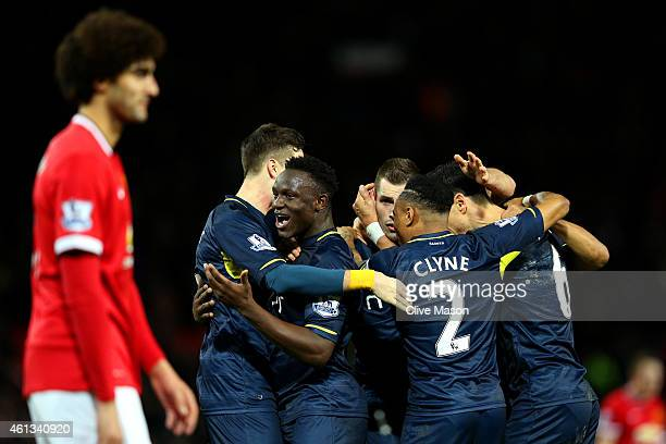 Southampton players celebrate victory after the Barclays Premier League match between Manchester United and Southampton at Old Trafford on January 11...