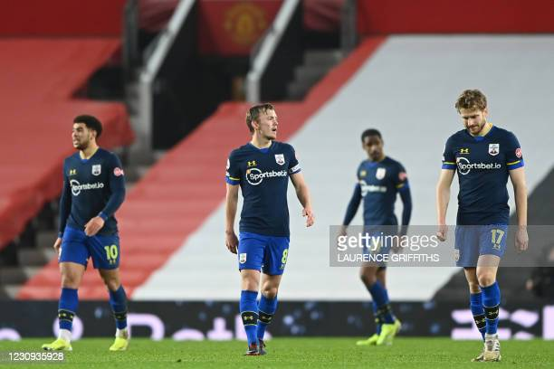 Southampton players react after conceding their eighth goal during the English Premier League football match between Manchester United and...