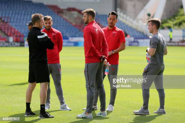 Southampton players stand on the pitch prior to the Premier League match between Huddersfield Town and Southampton at John Smith's Stadium on August...