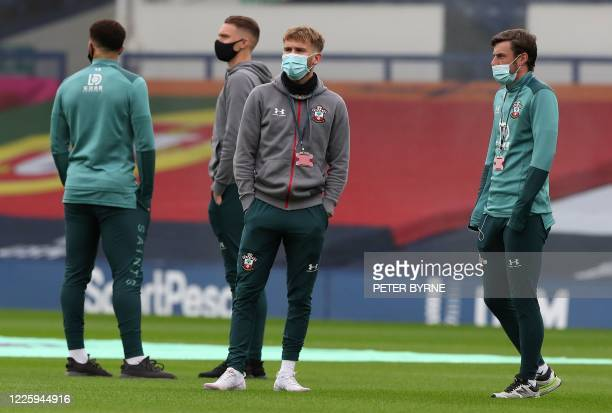 Southampton players wearing a face mask or covering due to the COVID19 pandemic stand on the pitch ahead of the English Premier League football match...