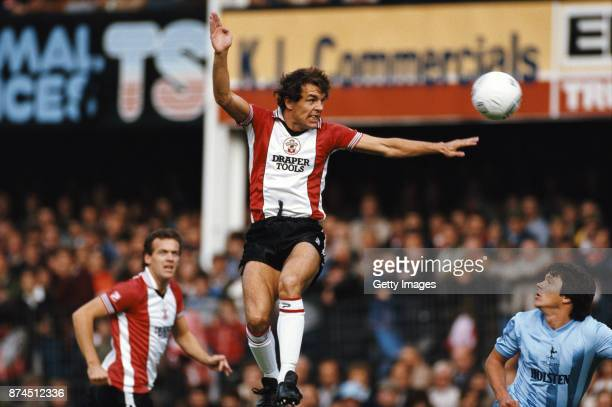 Southampton striker Joe Jordan rises to head goalwards watched by team mate Alan Curtis and Spurs defender Steve Perryman during a Division One match...