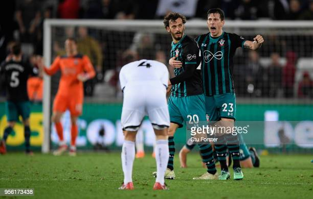Southampton striker Manolo Gabbiadini is congratulated by PierreEmile Hojbjerg on the final whistle after the Premier League match between Swansea...