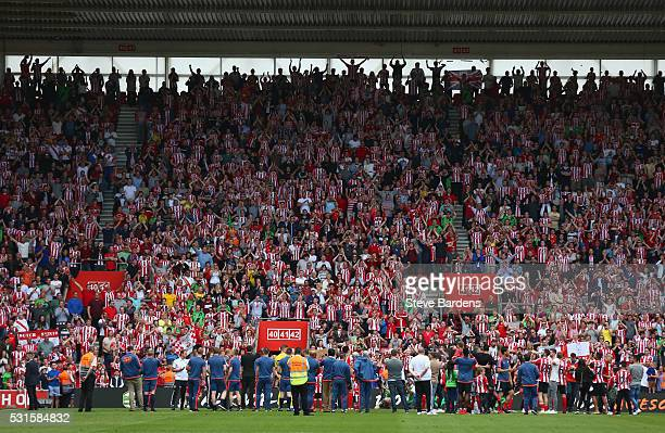 Southampton supporters cheer as players lap after the Barclays Premier League match between Southampton and Crystal Palace at St Mary's Stadium on...