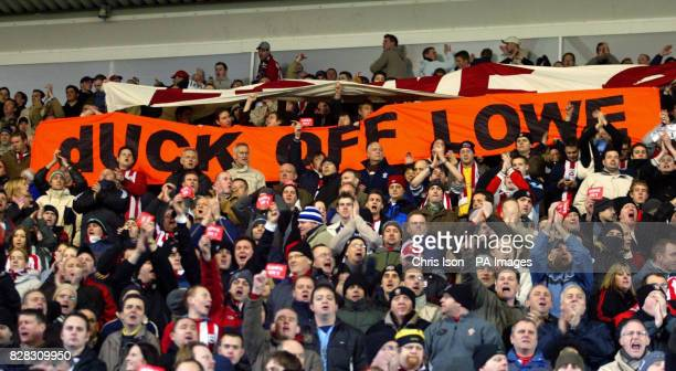 Southampton supporters hold up banners in protest at Chairman Rupert Lowe and mocking his love for duck shooting after their side's match against...