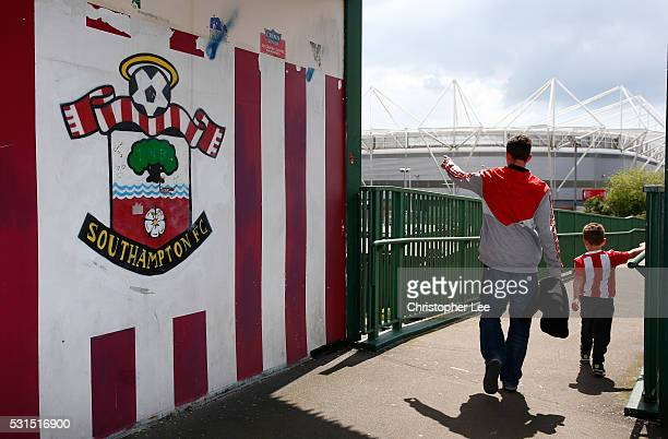 Southampton supporters make their way to the stadium prior to the Barclays Premier League match between Southampton and Crystal Palace at St Mary's...