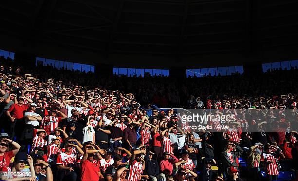 Southampton supporters watch the game in the sunshine during the Premier League match between Leicester City and Southampton at The King Power...