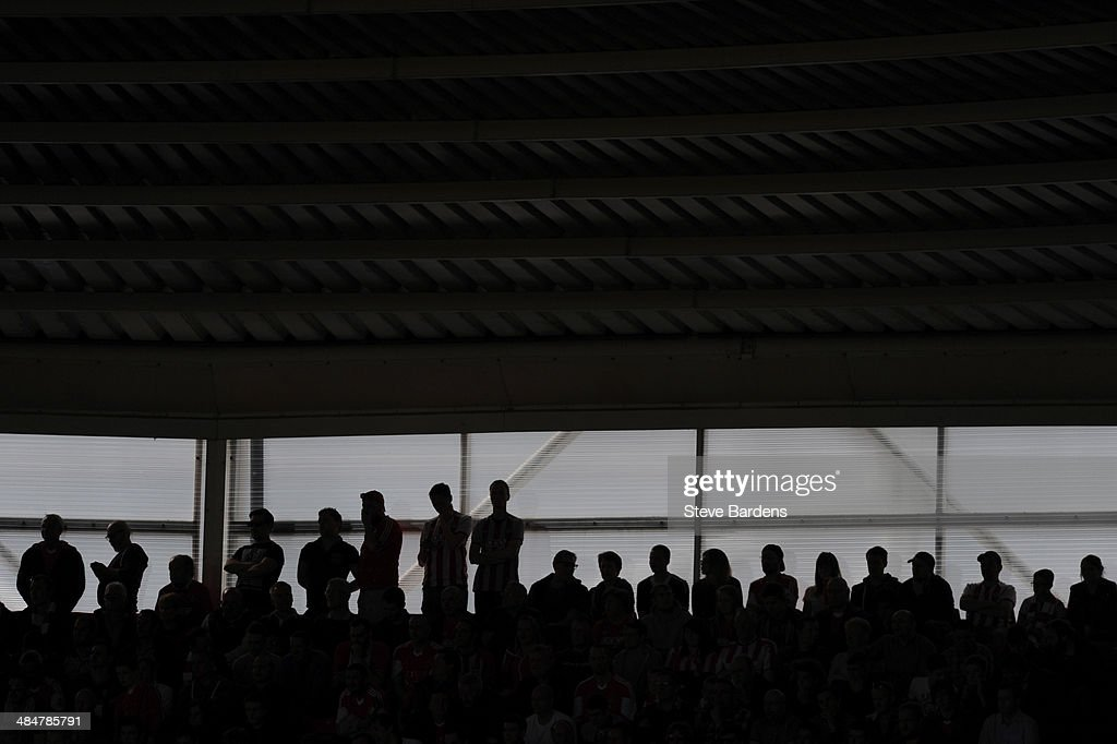 Southampton supporters watch the match during the Barclays Premier League match between Southampton and Cardiff City at St Mary's Stadium on April 12, 2014 in Southampton, England.