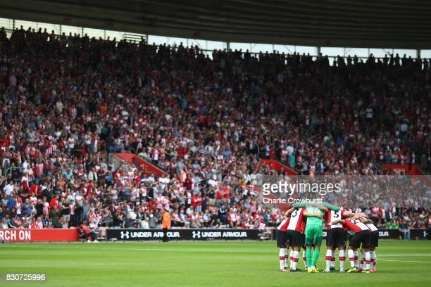 Southampton team in a huddle prior to the Premier League match between Southampton and Swansea City at St Mary's Stadium on August 12 2017 in...
