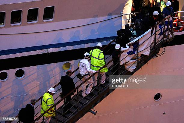 A group of men go onto the cruise ship Calypso before the passengers disembark after it arrived on Southampton Water England 06 May 2006 The ship...