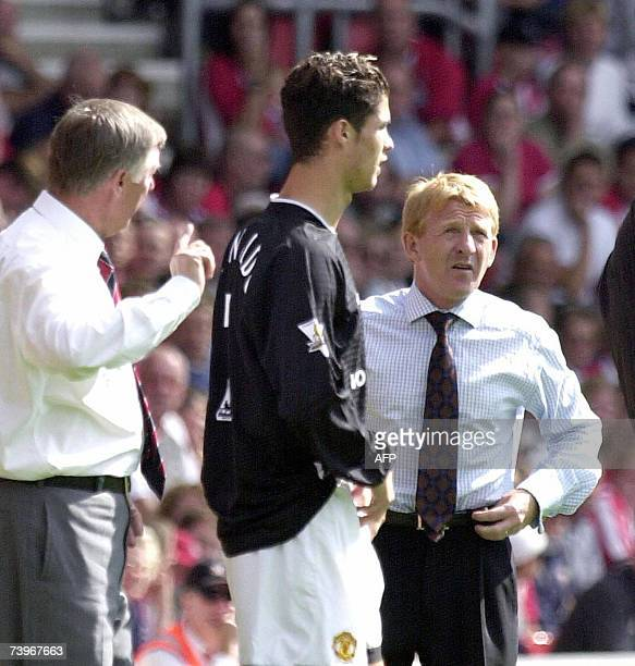 Southampton's coach Gordon Strachan looks at Sir Alex Ferguson about to send his new Portuguese player Cristiano Ronaldo on the pitch in Southampton...