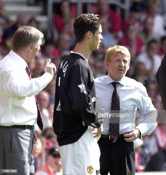 Southampton's coach Gordon Strachan looks at Sir Alex Ferguson about to send his new Portuguese player Cristiano Ronaldo on the pitch in Southampton...