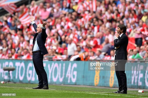 Southampton Welsh manager Mark Hughes and Chelsea's Italian head coach Antonio Conte react during the English FA Cup semifinal football match between...