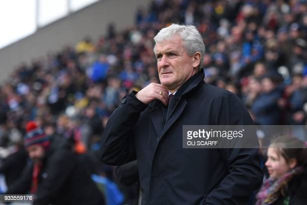 Southampton Welsh manager Mark Hughes arrives for the English FA Cup quarterfinal football match between Wigan Athletic and Southampton at DW Stadium...