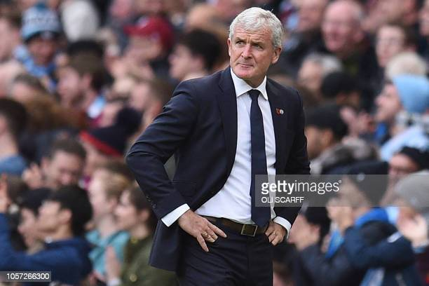 Southampton Welsh manager Mark Hughes gestures on the touchline after they concede the first goal during the English Premier League football match...