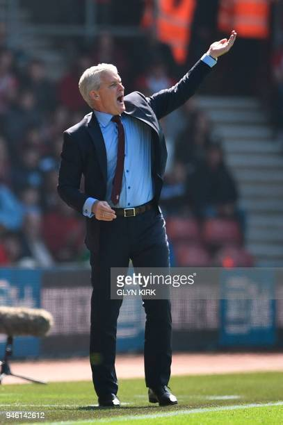 Southampton Welsh manager Mark Hughes gestures on the touchline during the English Premier League football match between Southampton and Chelsea at...