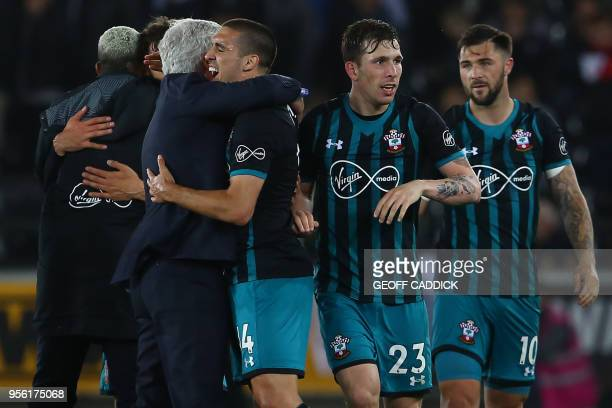 Southampton Welsh manager Mark Hughes hugs Southampton's Spanish midfielder Oriol Romeu following the English Premier League football match between...