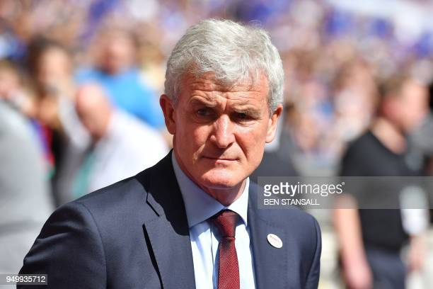 Southampton Welsh manager Mark Hughes reacts ahead of the English FA Cup semifinal football match between Chelsea and Southampton at Wembley Stadium...