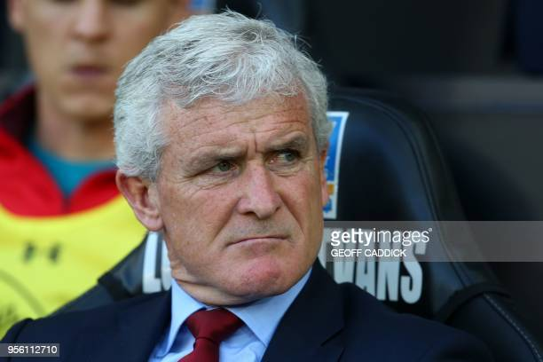 Southampton Welsh manager Mark Hughes reacts ahead of the English Premier League football match between Swansea City and Southampton at The Liberty...