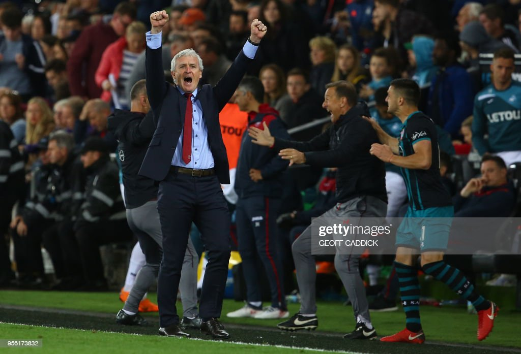 Southampton Welsh manager Mark Hughes reacts following the English Premier League football match between Swansea City and Southampton at The Liberty Stadium in Swansea, south Wales on May 8, 2018. - Southampton won the match 1-0. (Photo by Geoff CADDICK / AFP) / RESTRICTED TO EDITORIAL USE. No use with unauthorized audio, video, data, fixture lists, club/league logos or 'live' services. Online in-match use limited to 75 images, no video emulation. No use in betting, games or single club/league/player publications. /