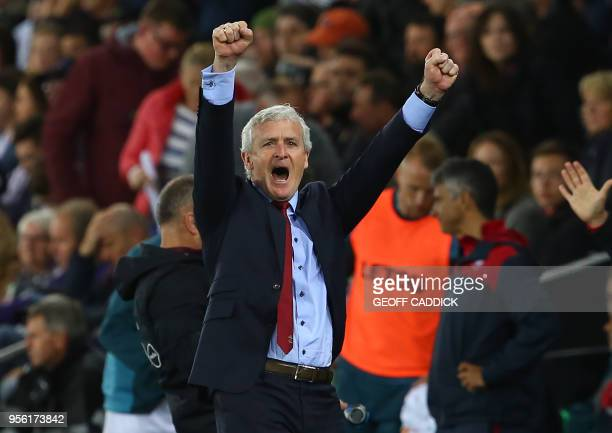 Southampton Welsh manager Mark Hughes reacts following the English Premier League football match between Swansea City and Southampton at The Liberty...