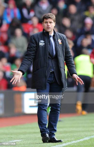 Southampton's Argentinian manager Mauricio Pochettino gestures to players during the English Premier League football match between Southampton and...