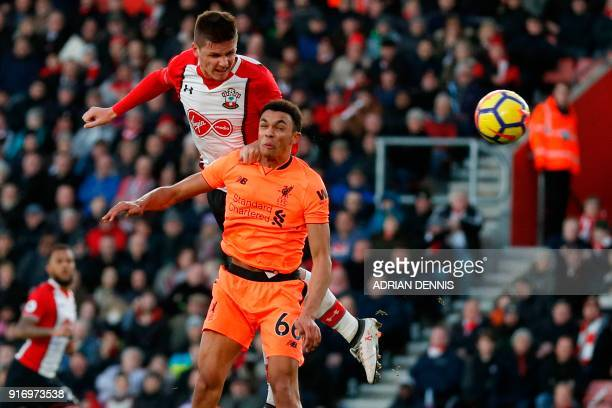 Southampton's Argentinian striker Guido Carrillo rises above Liverpool's English midfielder Trent AlexanderArnold to head the ball straight at the...