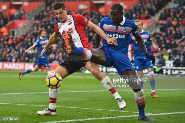 Southampton's Argentinian striker Guido Carrillo vies with Stoke City's French defender Kurt Zouma during the English Premier League football match...