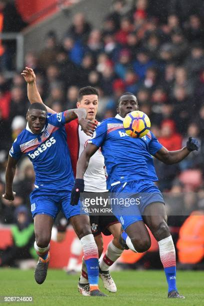 Southampton's Argentinian striker Guido Carrillo vies with Stoke City's Portugueseborn Dutch defender Bruno Martins Indi and Stoke City's French...