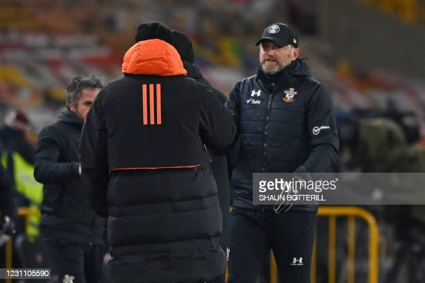 Southampton's Austrian manager Ralph Hasenhuttl goes to shake hands with Wolverhampton Wanderers' Portuguese head coach Nuno Espirito Santo after the...