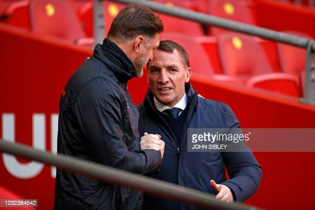 Southampton's Austrian manager Ralph Hasenhuttl greets Leicester City's Northern Irish manager Brendan Rodgers before the English FA Cup semi-final...