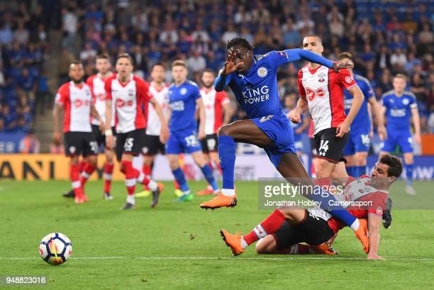 Southampton's Cedric Soares tackles Leicester City's Fousseni Diabate during the Premier League match between Leicester City and Southampton at The...