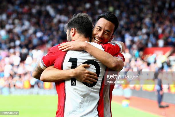 Southampton's Charlie Austin and Maya Yoshida celebrate during the Premier League match between Southampton and West Ham United at St Mary's Stadium...