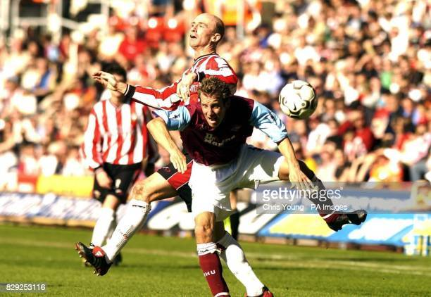 Southampton's Chris Marsden tangles with West Ham United's Lee Bowyer during their FA Barclaycard Premiership match at St Mary's Stadium Southampton...