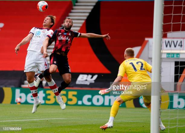 Southampton's Danish defender Jannik Vestergaard jumps for the ball with Bournemouth's English defender Steve Cook during the English Premier League...