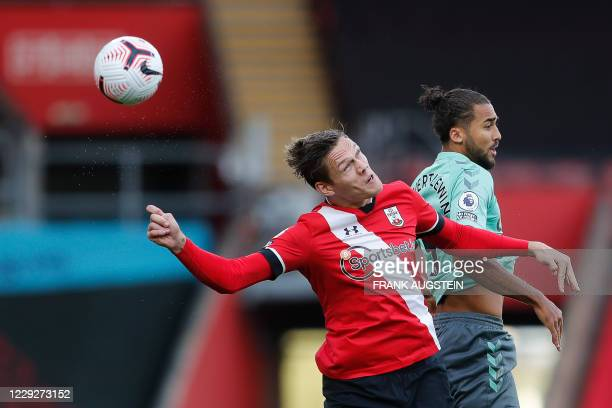Southampton's Danish defender Jannik Vestergaard jumps for the ball with Everton's English striker Dominic Calvert-Lewin during the English Premier...