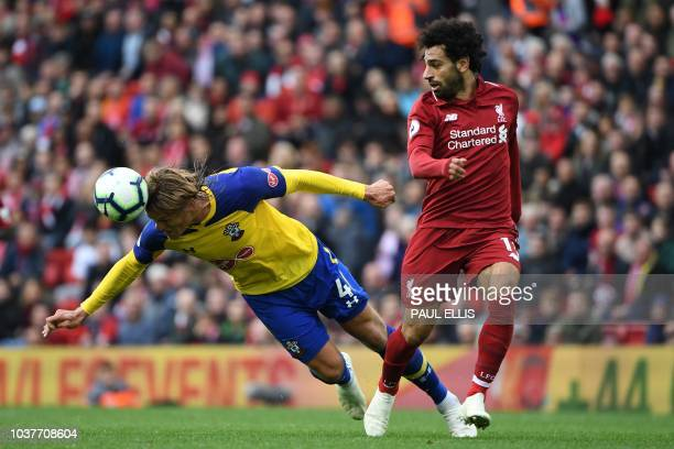 Southampton's Danish defender Jannik Vestergaard vies with Liverpool's Egyptian midfielder Mohamed Salah during the English Premier League football...