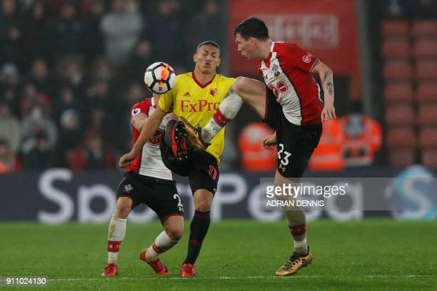 Southampton's Danish midfielder PierreEmile Hojbjerg challenges Watford's Brazilian striker Richarlison de Andrade during the English FA Cup fourth...