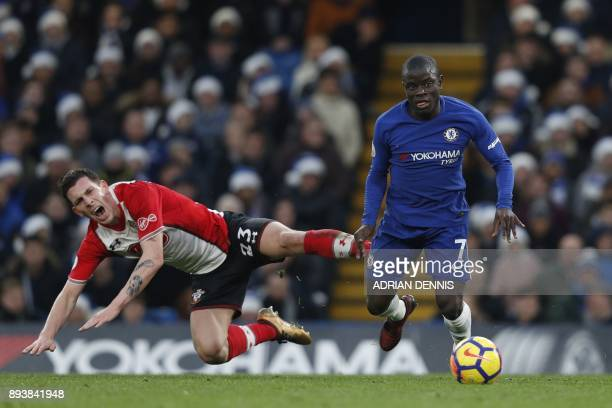 Southampton's Danish midfielder PierreEmile Hojbjerg falls by Chelsea's French midfielder N'Golo Kante during the English Premier League football...