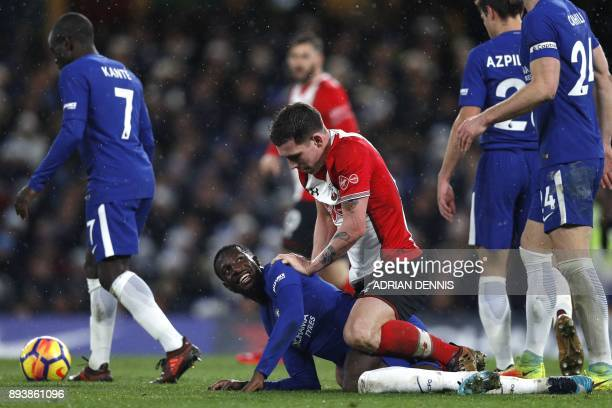 Southampton's Danish midfielder PierreEmile Hojbjerg jokes with Chelsea's French midfielder Tiemoue Bakayoko during the English Premier League...